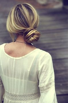 A casual low top knot is a great hair look for a laidback bride!