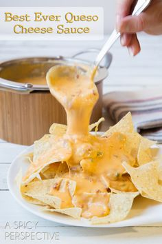 The BEST EVER Nacho Cheese Sauce (Queso) Recipe ~ Start with fresh onions, garlic and jalapeños, sautéed until soft, then add creamy half & half, smoky chipotle peppers, and three cheeses, including smoked cheddar to add a huge punch of flavor.