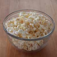 Microwave Kettle Corn: In a small bowl mix together: 1/4 cup popcorn kernels,  1/2 tsp oil, 1/2 tsp vanilla, 1/4 tsp popcorn salt, 1-1/2 tsp confectioner's sugar.  Stir with a spoon until everything is well-mixed.  Pour into a brown paper bag.  Fold the bag over 2 times, and place upright in the microwave. Cook for approx 2 mins.    Microwave until popping slows down a couple pops per second.