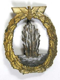 Kriegsmarine Minesweeper badge with early fire gilt finish. Reverse is marked Schwerin.