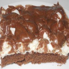 """We have always called this a cake but to me it is more """"brownie"""" like. No matter what you call them, they are sinful! I like them best warm and gooey! Easy to make and great to eat!"""