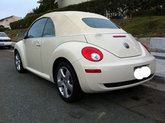 I have always wanted a cream convertible Volkswagen Beetle!