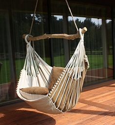 Hammock chair. Hammock chair is made in Latvia from natural materials. Designed in Eco style.The crossbar comes from wild beaches of Baltic Sea and is individually selected for each chair. There is fold-out leg support letting you to stretch out and lift off the ground. Size of the chair: width 27.6 inches height 27.6 inches The length of the seat with the leg rest included: 47.2 inches Width of the wooden bar: 47.2 inches The price includes: hanging hardware; 2 pillows (pillowcases are...