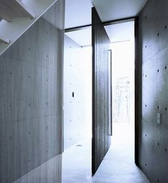 Pivot door at Shigita House, Osaka by Masato Sekiya.