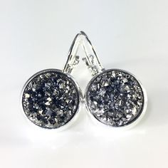 Gunmetal grey Druzy style earrings Handmade by me metallic chunky grey Druzy style 1 inch silver plated frenchback earrings. Bundle & save 15%. Price FIRM if purchasing 1 pair. Each piece varies slightly in shape. Made of resin. thejeweladdict Jewelry Earrings