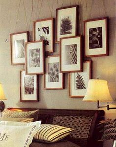 The latest Pottery Barn catalog, featured this interesting display of frames. The photo doesn't show how they are hung, but we could see maybe hanging them from a rod. However, we are a little paranoid about hanging them above a bed.