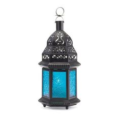 "Moroccan Lantern Blue Glass Candle Holder Candleholder by Furniture Creations. $6.35. The cobalt hues of this exotic metal candle lantern bring to mind images of mysterious Morocco! Suitable for hanging or use as a freestanding lamp. For use with tealights or votive candles only (not included). Metal and glass. 4 1/2"" x 3 3/4"" x 8 1/4"" high."