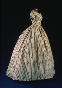 Mary Lincoln wore this silk taffeta two-piece dress in 1861, with an evening bodice as the top piece. The pattern of black stripes and purple flowers is woven into the silk. Later in the 19th century, the original evening bodice was replaced with this daytime bodice made of fabric taken from the skirt.