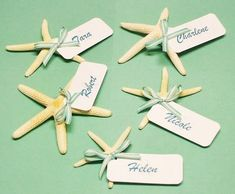Use starfish wedding place cards to tell your guests where to sit! Attach a card naming the guest and table number. Have a place card at their assigned seat.