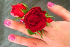 Now this is a way to present red roses ... by way of ring corsage!