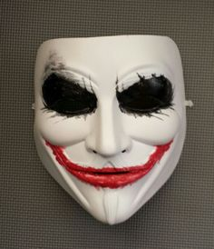 i'm not sure if i want to add a cheesy smile or a joker smile to my mask. Creepy Masks, Cool Masks, Studio Background Images, Black Background Images, Looks Halloween, Halloween Masks, Joker Face Paint, Anonymous Maske, V For Vendetta