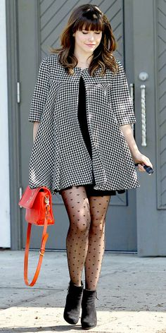 Sophia Bush black and white print coat over black shift, heart print stockings, black ankle booties and bright orange bag