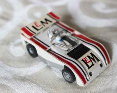 Afx aurora l & m lola can am vintage ho slot car white the past, Porsche, Audi, Slot Car Racing, Slot Car Tracks, Hot Wheels, Afx Slot Cars, Las Vegas, Cars 1, Diabetic Dog