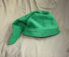 The Legend of Zelda: Link's Hat + Pattern - works pretty well. Instructions are pretty scarce though. To put on the brim, fold brim material right side out, sew to right side edge of hat, you will have three layers. Make sure you have left over to sew a seam in the brim.