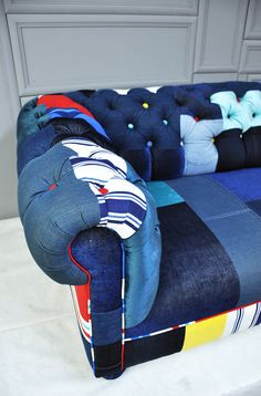 denim chesterfield patchwork sofa:) I'd love to have something this completely unique among all my wood antique and leather furniture