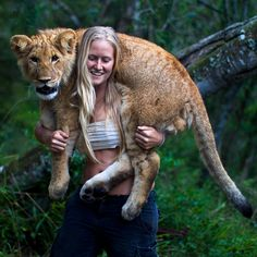 Tamblyn Williams has a pet baby lion. (He's 6 months old, and getting a little big now, but she still carries him.)