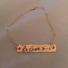 """New! Handmade Gold Be Brave Bar Bracelet❤️ One 1/4"""" x 1"""" gold filled bar is cut from 18 gauge gold filled sheet. It is hammered, and then stamped with a cute little arrow, with the words """"be brave"""" stamped on it. It is attached to a delicate, but sturdy sterling silver cable chain. 8 inches in length. Handmade Jewelry Bracelets"""