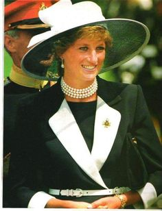Princess Diana, looks like 1995 Germany. Colours all wrong but same outfit and multi-stringed pearl choker. July 22, 1995: Diana, Princess of Wales presents new colours to the Light Dragoon Guards Regiment, in Bergen-Hohne. on July 22 1995, in Bergen-Hohne, Germany. See Getty images photo this board..or page 13 here for more of this event: http://www.gettyimages.co.uk/photos/princess-diana-suits?excludenudity=true&mediatype=photography&page=13&phrase=princess%20diana%20suits&sort=mostpopular