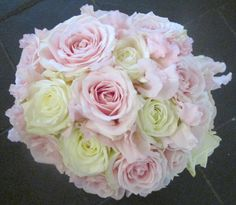 Handtied bouquet of roses and sweetpeas in pink and ivory
