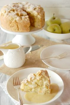 Ingredients FOR THE CAKE: 3 C. Flour 2 t. Baking Powder 1/8 t. Salt 1/4 t. Cloves, ground 1/4 t. Nutmeg, ground 6 oz. Butter 3/4 C. Sugar 4 large Granny Smith apples(I used golden delicious to great affect) 2 Eggs 1/4 C. Milk 2 T. Sugar(for sprinkling on top of cake) FOR THE CUSTARD: 6 large Egg Yolks 6 T. Sugar 2 C. Whole Milk 1 1/2 t. Vanilla.