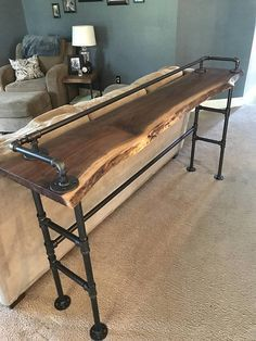 Thanks for looking at this CaseConcept2000 creation!! CaseConcept live edge wood is reclaimed from power companies, local Michigan municipalities and wind fallen trees. Never harvested just for lumbar. This live edge walnut sofa bar table is great for a space behind a couch or sofa for some extra viewing seats. The beautiful live edge wood and steel pipe legs give this piece a unique industrial look while maintaining its rustic feel. The wood used for this table is planed and sanded for an…