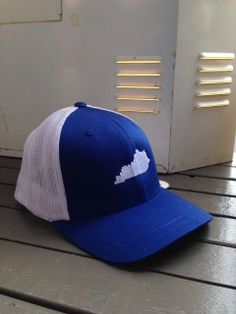 05daf0917fd The great state of Kentucky is embroidered on this basic trucker style in  royal blue and white. Patented FlexFit elastic mesh construction.