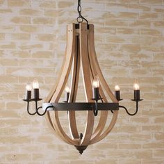 Wooden Wine Barrel Stave Chandelier Inspired by wooden slats from the vineyard, this bent-wood chandelier has a naturally-aged look in dark or light finish. Strapped with a dark bronze metal ring and 6 arms, its rustic simplicity is a favorite.