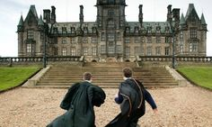 Well it is a tiny bit like Hogwarts... two befrocked pupils run towards Fettes College in Edinburgh. Photograph: Murdo Macleod