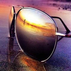 Glasses in the sunset...a photographer w/ a clever eye!