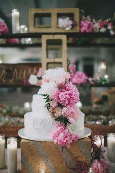 cake table with flowers, photo by Rad + In Love http://ruffledblog.com/kona-kai-resort-wedding #weddingcake #cakes