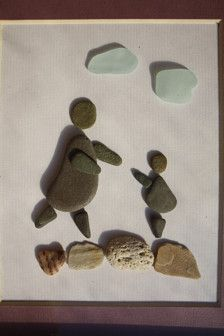 Thank you for visiting my shop!  Mom and a baby. Made from pebbles, seaglass and seashells. Comes in a white glass frame with mat. 18,7 x 21,5 cm or 7,36 x 8,46 inches  Sea glass and pebbles are hand picked by me and my wife all over the world. Than put together in little stories.