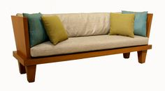 Indoor bench/ homemade couch. I would eliminate the wood sides altogether.