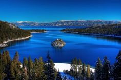 Beautiful Lake Tahoe lies in the Sierra Nevada mountain range along the border of California and Nevada in the United States. With 496 square kilometers (192 sq miles) of surface area and lovely mountain scenery, the lake is a major tourist destination year round. There are over 12 ski resorts at Lake Tahoe and visitors can find all manner of winter activities here including snowboarding, skiing, snowshoeing, snowmobiling, snow tubing, and more.