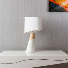 Envy Lighting modern designer table lamp in white and light oak. Stunning ceramic/wooden base with wedge shape white shade. High end quality is obvious. Simplicity is the key for its beauty and elegance. Exquisite delicate white fabric shade looks like a million dollars.