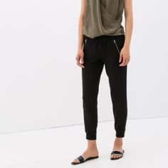 ZARA zipper joggers Multiple zippers on the waist area and on the ankles they are gorgeous. You can easily wear them up or down. Never worn. Perfect condition. Zara Pants Track Pants & Joggers