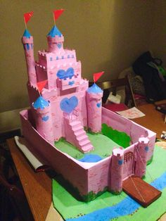 Painted pink in poster paint mixed with PVA glue to stop chipping of paint. Also gave the castle a small garden, bushes and a pond.