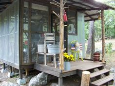 Outdoor Screen Kitchen, It is a outdoor kitchen area for a cabin get away. Open and airy with everything needed to cook. Wonderful addition to a mountain retreat. Old wooden wringer wash station. Notice the cedar support poles.