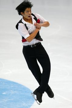 Japan's Takahiko Kozuka performs during the Cup of Russia ISU Grand Prix figure skating event in Moscow, Russia, Friday, Nov. 14, 2014. (AP Photo/Pavel Golovkin) (1289×1934)