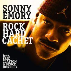 El baterista Sonny Emorye edita en 2013 su disco Rock Hard Cachet en el que participan Eric Clapton y Bruce Hornsby