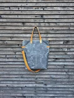 This bag is made from waxed canvas and vegetable tanned leather, I used cognac colour leather and charcoal grey waxed canvas. This one was made for the active parents, convertible into a pannier bag, perfect for when you take your baby out on a nice bike ride. I made it big enough for