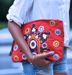 Street deets: tribal clutch completes the look