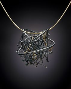 Andrea Williams: The Birds Nest: Inspired by those busy little springtime birds. This pendant consists of many little interwoven twigs of reclaimed Sterling and 18 k gold.