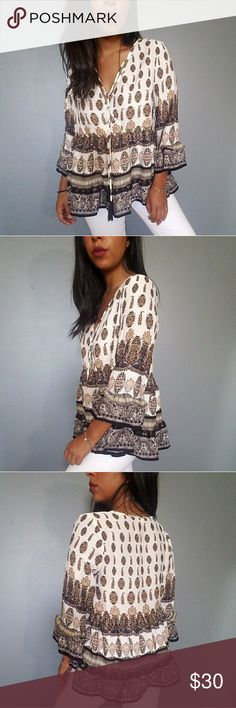 IVORY TAN BLACK PAISLEY PRINT SURPLICE TOP LOVE LOVE LOVE this top! Beautiful taupe/tan/black print. 3/4 bell sleeves. Ruffle hemline. Surplice bodice. Tassled ties. Flowy and super chic! Looks great with white leggings/demim❤ Fits TTS.    SIZES AVAILABLE:  S M L  MODELING SIZE: MEDIUM    PRICE FIRM UNLESS BUNDLED  Tops