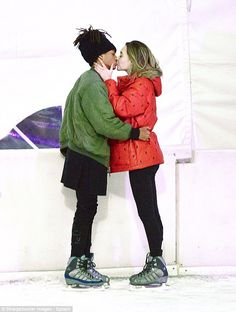 Loved-up: Things are still going strong between Jaden Smith and his model girlfriend Sarah Snyder as they packed on the PDA during a romantic ice skating date in Los Angeles on Monday