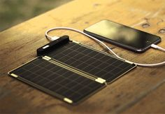Solar Paper - It's a solar charger that is quite thin. Remarkably thin even: .15in. And only slightly larger than your phone itself, this ultra-light 4 oz. solar panel charger will fully re-charge your iPhone 6 in about 2.5 hours. | werd.com