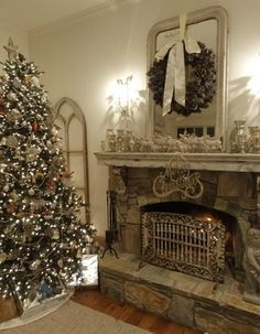 """The first house on the tour was the gorgeous home of the Cavalier family.  Angie has an incredible eye for detail and knows how to use """"shabby"""" antiques to make her house feel warm and inviting.  The shades of white mixed with vintage silver decor made it magical."""