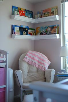 Corner bookshelves over rocker