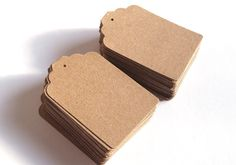 100 Kraft Tags Wedding Favour Luggage Tags. £4.00, via Etsy.