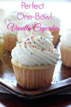 """Perfect """"One Bowl"""" Vanilla Cupcakes with Vanilla Buttercream Frosting - these are the BEST! So easy to make at home and better than the bakery!"""