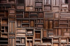 A detail of a wall made from old doors at the Six Senses Con Dao resort.